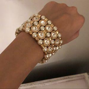 Pearls and rhinestones on gold bracelet